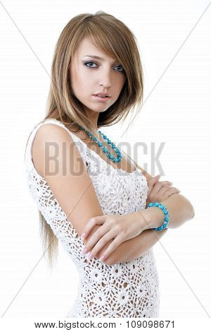 Sexy model posing in a studio in a handmade knitted dress isolated on white