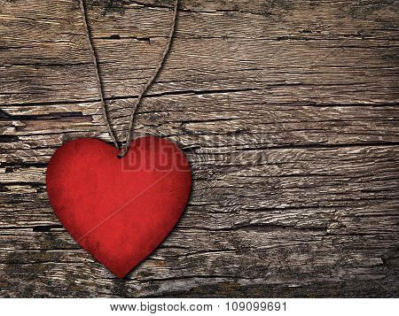 Red Paper Heart On A String On The Wooden Background