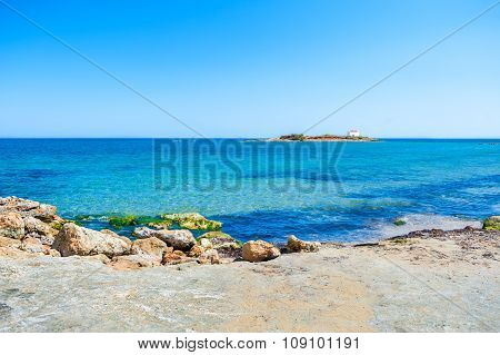 Beautiful Beach With Turquoise Water And Small Island With Chapel