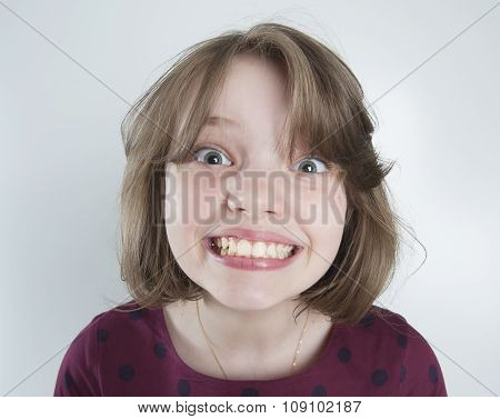 Ten-year Girl With A Funny Smile..