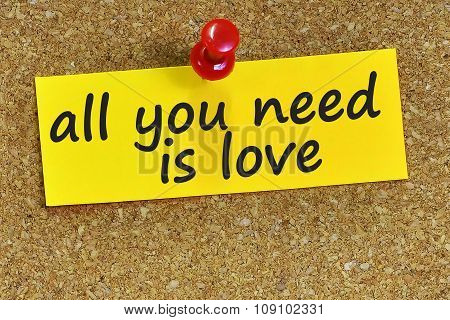 All You Need Is Love Word On Yellow Notepaper With Cork Background