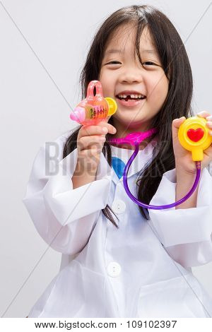 Little Girl Playing Doctor Background / Little Girl Playing Doctor / Little Girl Wearing Doctor Dres