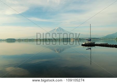 Travel And Vacation Concept - Fuji Snow Mountain With Sailing Boat At Lake Kawaguchiko, Japan