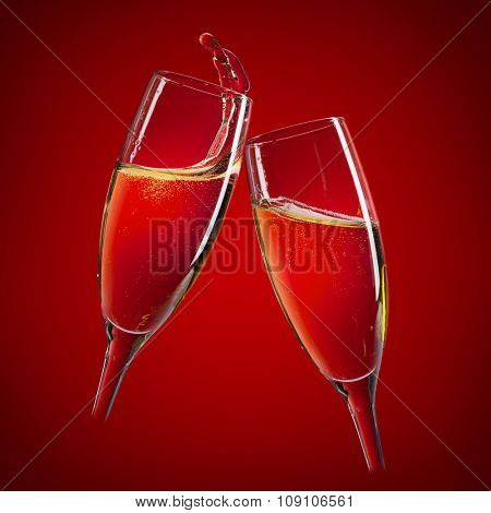 Two champagne glasses over red background