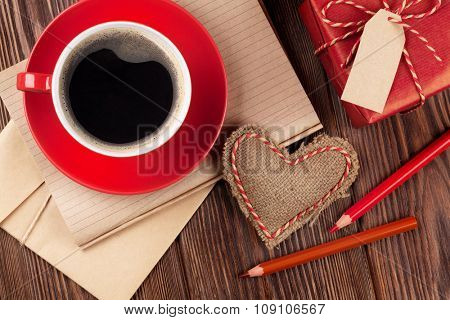Valentines day toy heart, coffee cup and gift box. Top view
