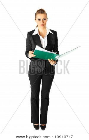 Full length portrait of thoughtful modern business woman holding folders with documents in hands