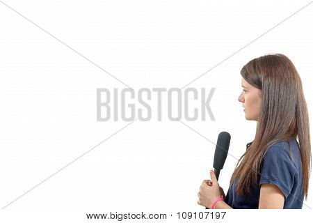 A Young Woman Journalist With A Microphone