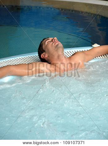 Happy Man Enjoying A swimming pool