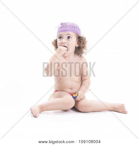 Sweet Female Child Eating A Candy