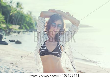 Beautiful girl sunrise at seaside. Beach sunset evening. concept love romance