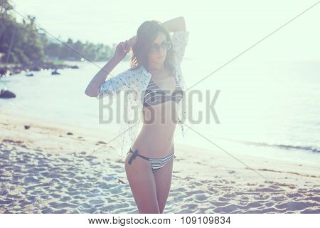 Beautiful girl sunrise at seaside. Beach sunset evening. concept love romance