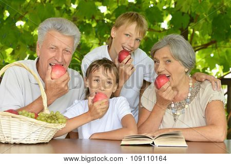 Grandparents and  grandsons with apples