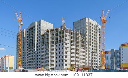 Construction Of New Multi-storey Panel House. Three Tower Cranes