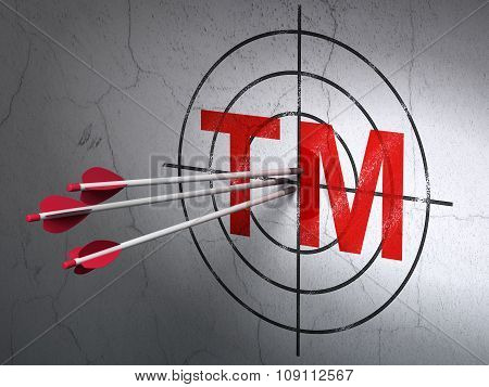 Law concept: arrows in Trademark target on wall background
