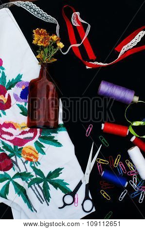 Scissors, bobbins with thread. Set of colored threads in the bobbin with scissors. Sewing kit. Sewin