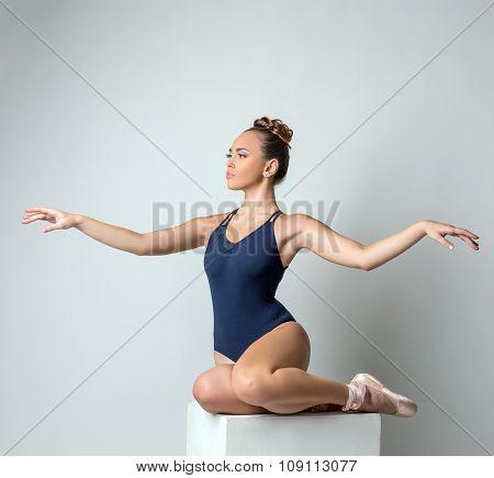 Attractive dancer posing gracefully waving hands