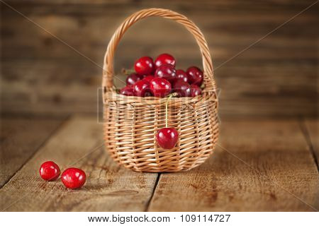 Ripe Sweet Red Cherries in Wicker Basket