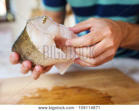 Man holding zander fillets