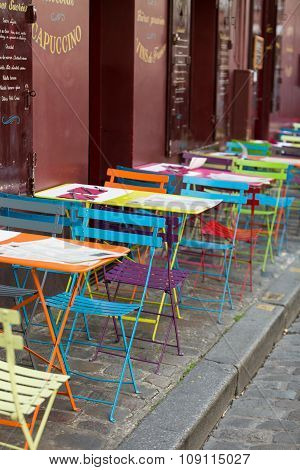 PARIS, FRANCE - SEPTEMBER 10, 2015: Paris - Very colorful Parisian outdoor cafe in Montmartre