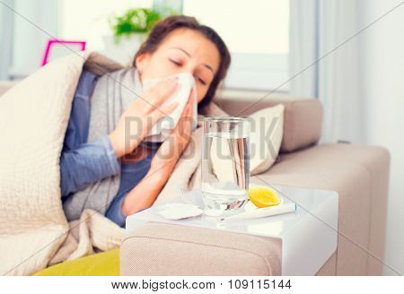 Sick Woman .Flu. Woman Caught Cold. Sneezing into Tissue. Headache. Virus .Medicines