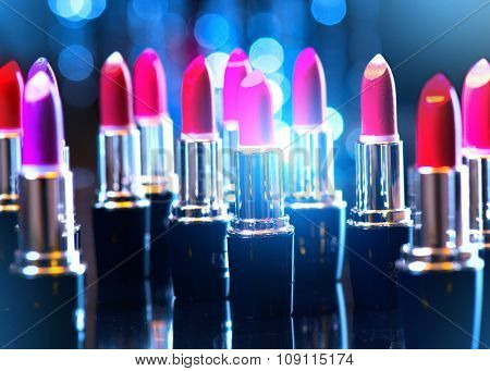Lipstick. Makeup concept. Fashion Colorful Lipsticks. Professional Makeup and Beauty. Beautiful Make-up. Lipgloss. Lipsticks closeup over blinking bokeh background