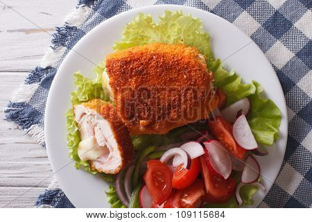Chicken Schnitzel Cordon Bleu And A Salad Close-up. Horizontal Top View