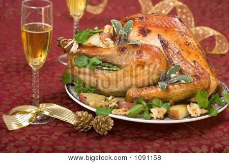 Christmas Turkey On Holiday Table And Flute Of Champagne