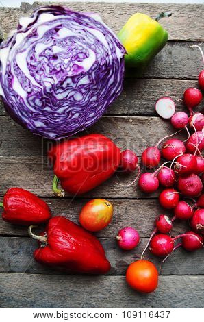 Vegetables on vintage wood background - autumn harvest. Fresh vegetable on wooden table. Top view. A
