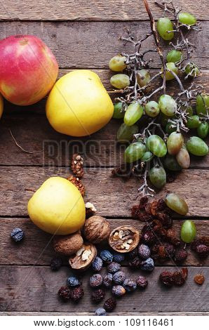 Assortment of fruits, wood background. Autumn fruit background. Nature background. Ripe yellow apple