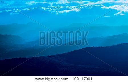 Mountain Silhouette With Fog