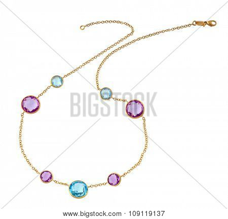 gold necklace witn precious stones