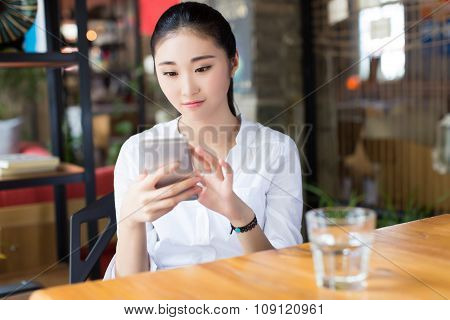 Young Businesswoman Drinking Water