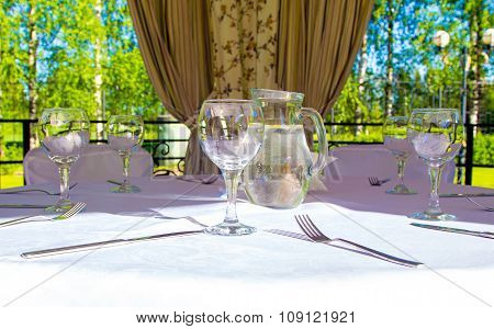 Table with glasses and forks