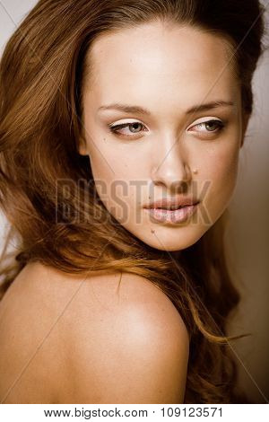 young pure brunette woman close up isolated