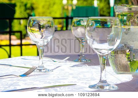 Glasses and white tablecloth on table