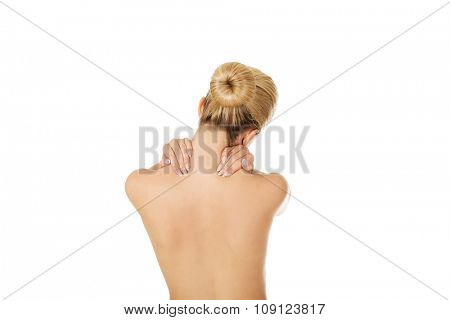 Young woman with neck pain, isolated on white.