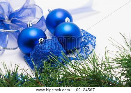 Blue Christmas ball with lace on a blurred background of balls o