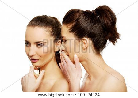 Beautiful two women sharing a secret.