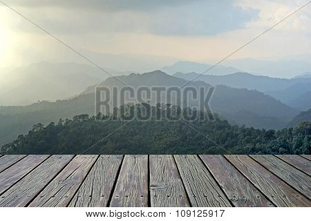 Wooden Floor With Misty Mountain Hills Landscape Background