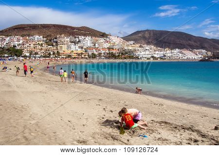 Tenerife, Canary Islands - January 09, 2015: People Relaxing On The Las Americas Beach, One Of The M