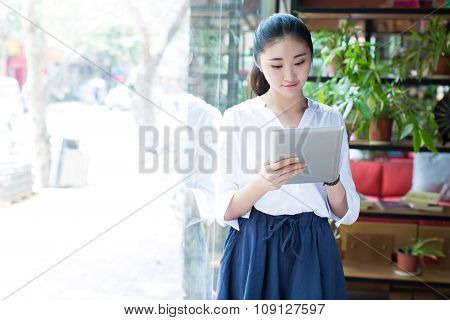 Beautiful Female Using Digital Tablet In Cafe