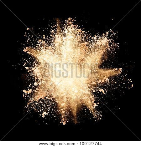 Freeze motion of yellow dust explosions isolated on black background