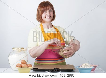 Woman Kneads Dough For Biscuits..