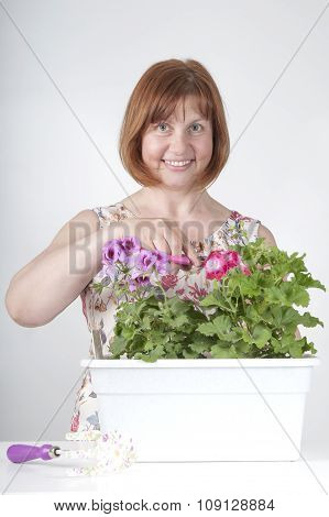 Middle-aged Woman Taking Care Of Flowers..