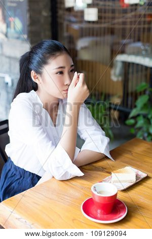 Girl Eating A Cake In Cafe