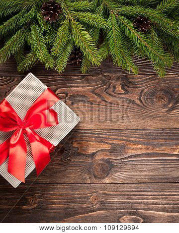 Fir Tree And Gift Box On Dark Wooden Background