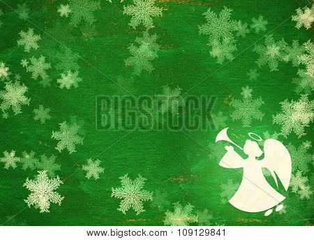 Horizontal grunge Christmas background of green color with snowflakes, angel  and paper texture