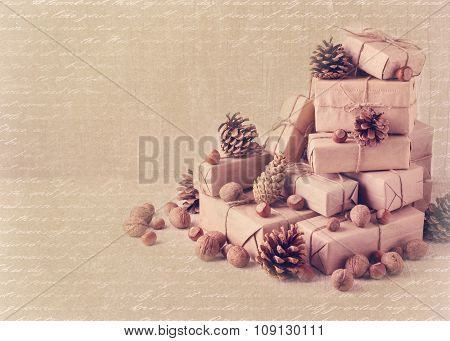 Christmas Card. Christmas  Gifts, Nuts And Fir Cones. Vintage Stile.