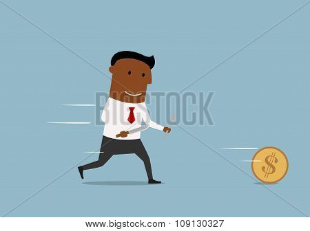 Cartoon businessman chases golden dollar coin