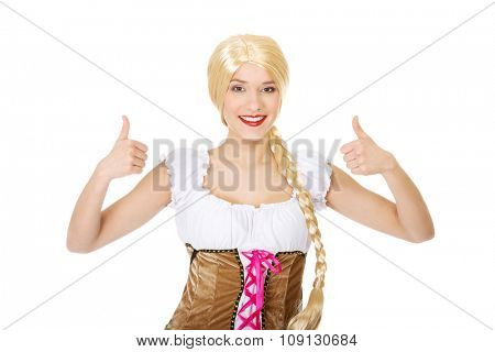 Woman wearing traditional Bavarian dress with thumbs up.